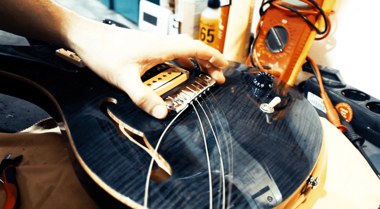 changing the strings of an electric guitar. Black Bedroom Furniture Sets. Home Design Ideas